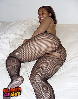 Black girl in fishnets stretching widely
